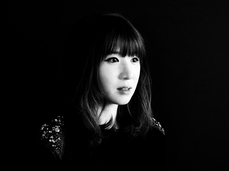 A black and white portrait of Chloe Koo