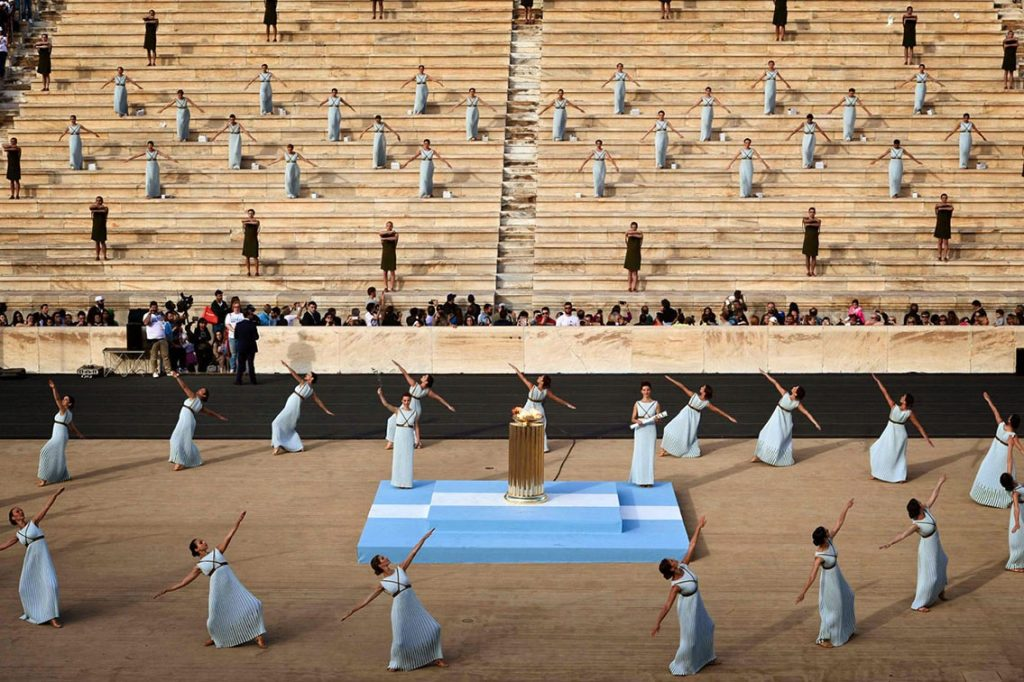 Priestesses perform during the handover ceremony of the Olympic flame at the Panathinean stadium in Athens, on April 27, 2016. Greece on April 27 handed over to Brazilian officials the Olympic flame of the Rio Games as the 100-day countdown to the August 5 opening ceremony begins. / AFP PHOTO / LOUISA GOULIAMAKILOUISA GOULIAMAKI/AFP/Getty Images ** OUTS - ELSENT, FPG, CM - OUTS * NM, PH, VA if sourced by CT, LA or MoD **
