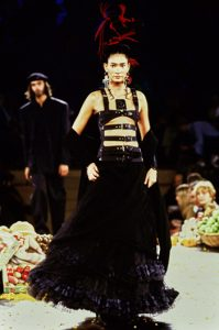 A model walks down the catwalk wearing an outfit designed by Jean Paul Gaultier