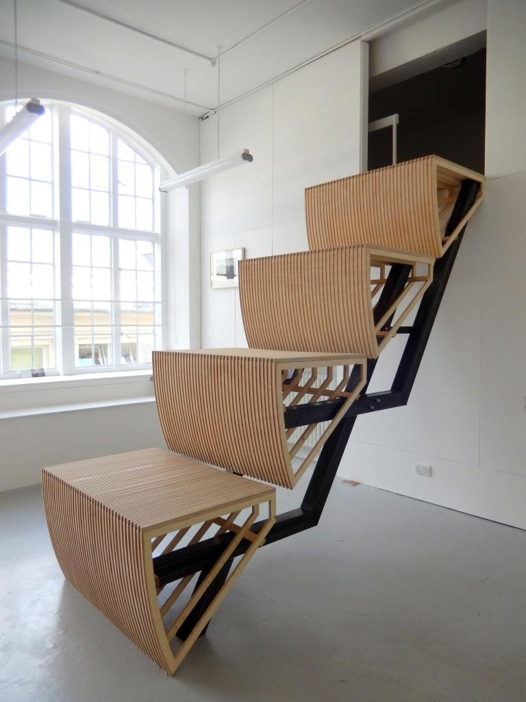 Image of large sculpture. Wooden escalator steps leading up to the ceiling of one of Camberwell's Painting studios