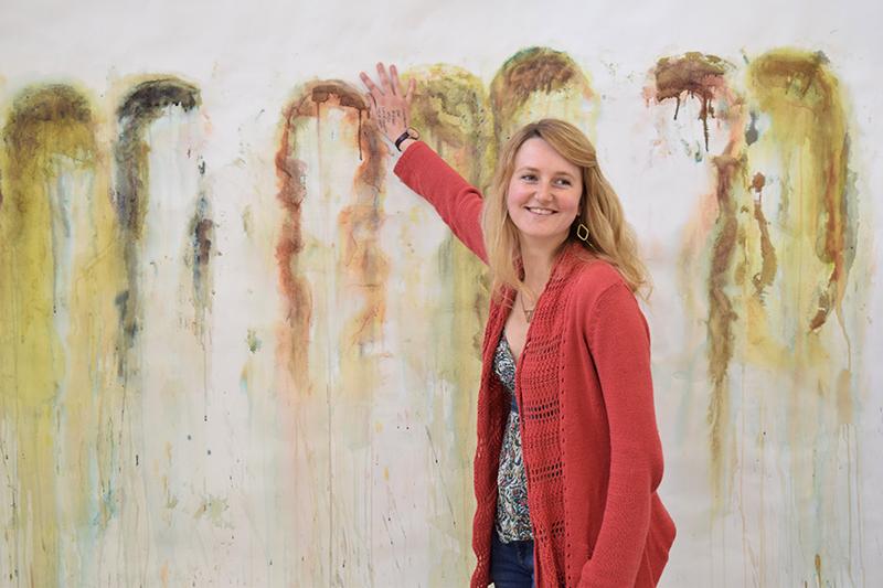 BA Painting student Damaris Athene holding her paint
