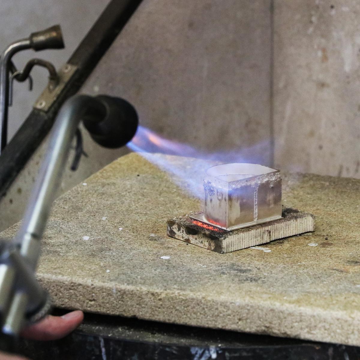 Student silversmithing.
