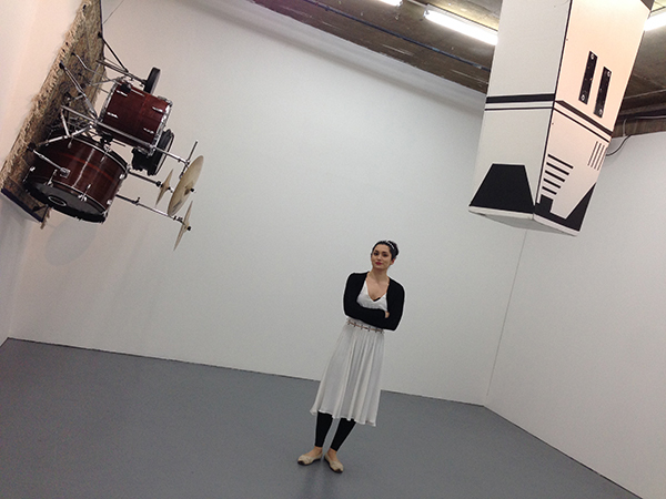 Sarah Fortais with her work 123 Unfinished