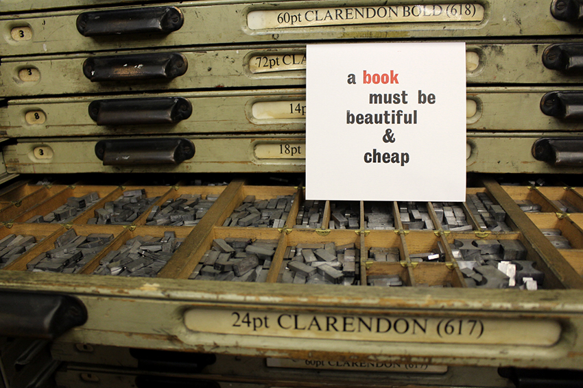 Photograph of typographic work reading ' a book must be beautiful and cheap'