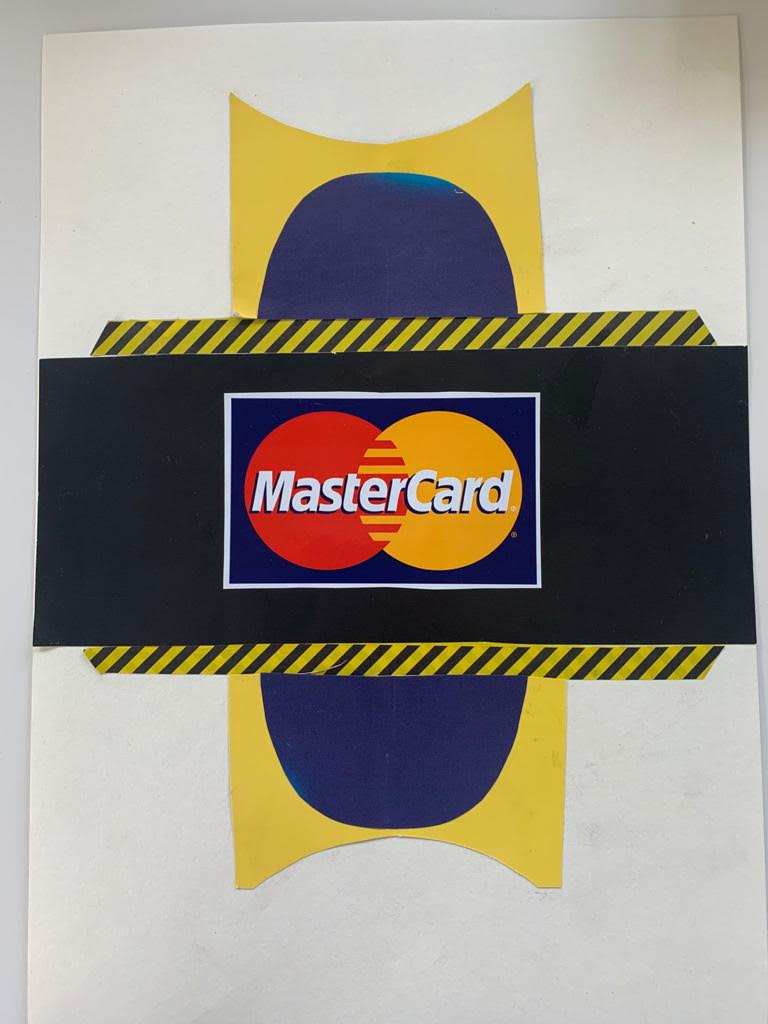 Portrait image of cut up materials put together with the MasterCard logo in the centre resting on a black rectangular paper