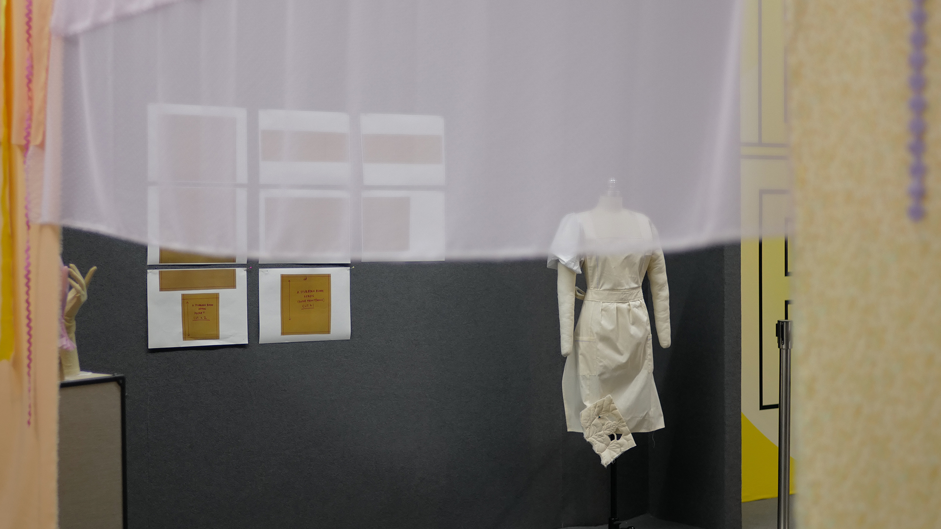 mannequin in front of wall mounted document display