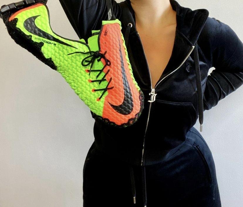 Volt and orange football boots reworked as a handbag