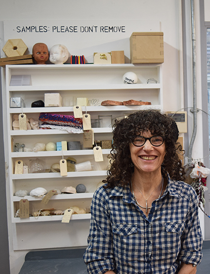 3D Workshop Technician Manda Helal in the workshop pictured with mould and casting samples