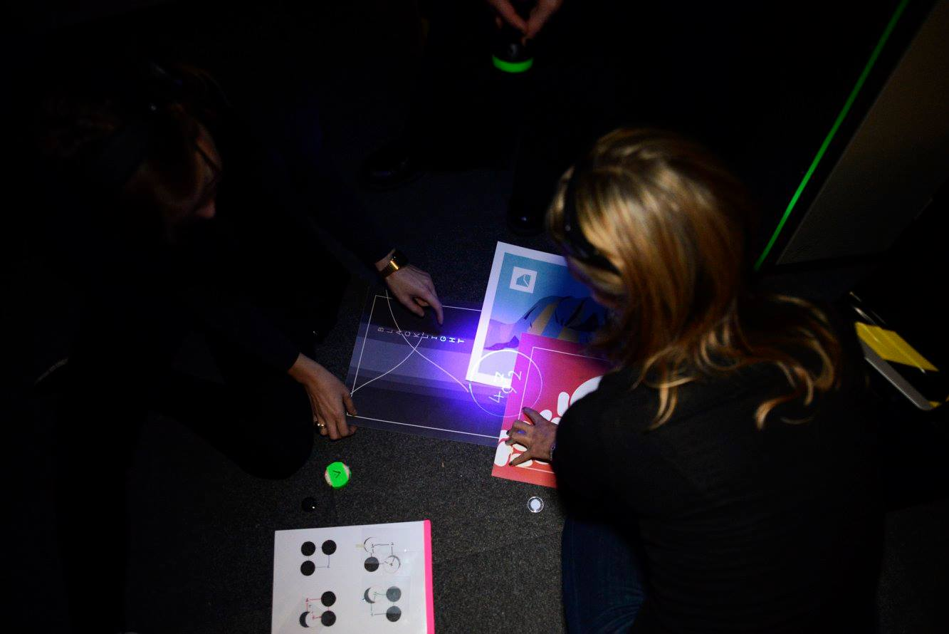 Using UV light, players have to piece together a pattern using objects found in the room