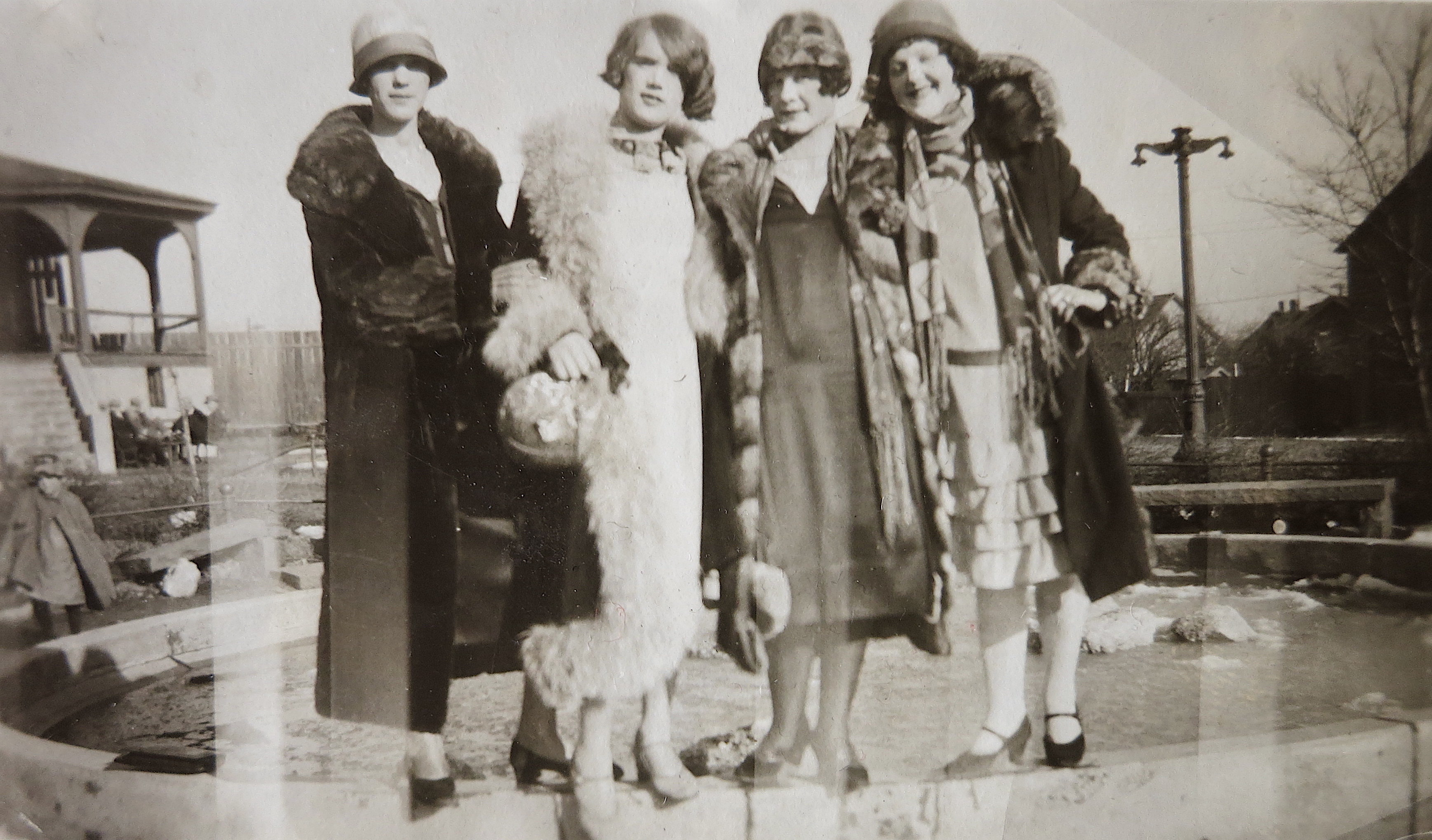 A black and white photo of a group of young women dressed as flappers in the 1920s