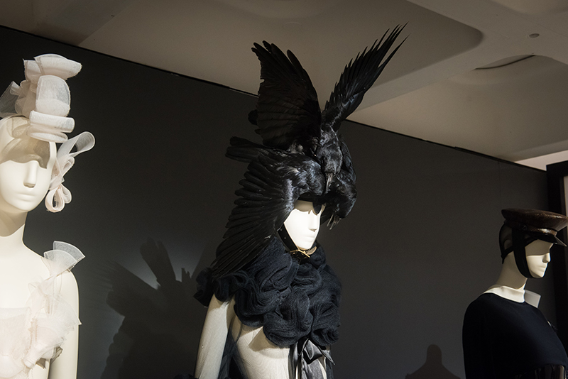 Manequin wears a headress made of raven feathers