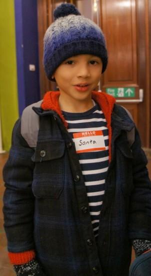 child with santa sticker