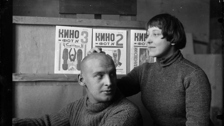 Credit: Michail Kaufman, A. Rodchenko and V. Stepanova in the workshop. (in front of Kino-phot magazine covers), 1923 Courtesy Rodchenko and Stepanova Archives, Moscow