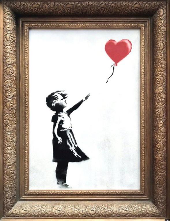 A print of a girl releasing a heart shaped balloon