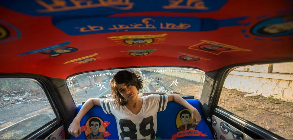 Roshnee Desai, MA Graphic Moving Image inside her Mumbai taxi design project.