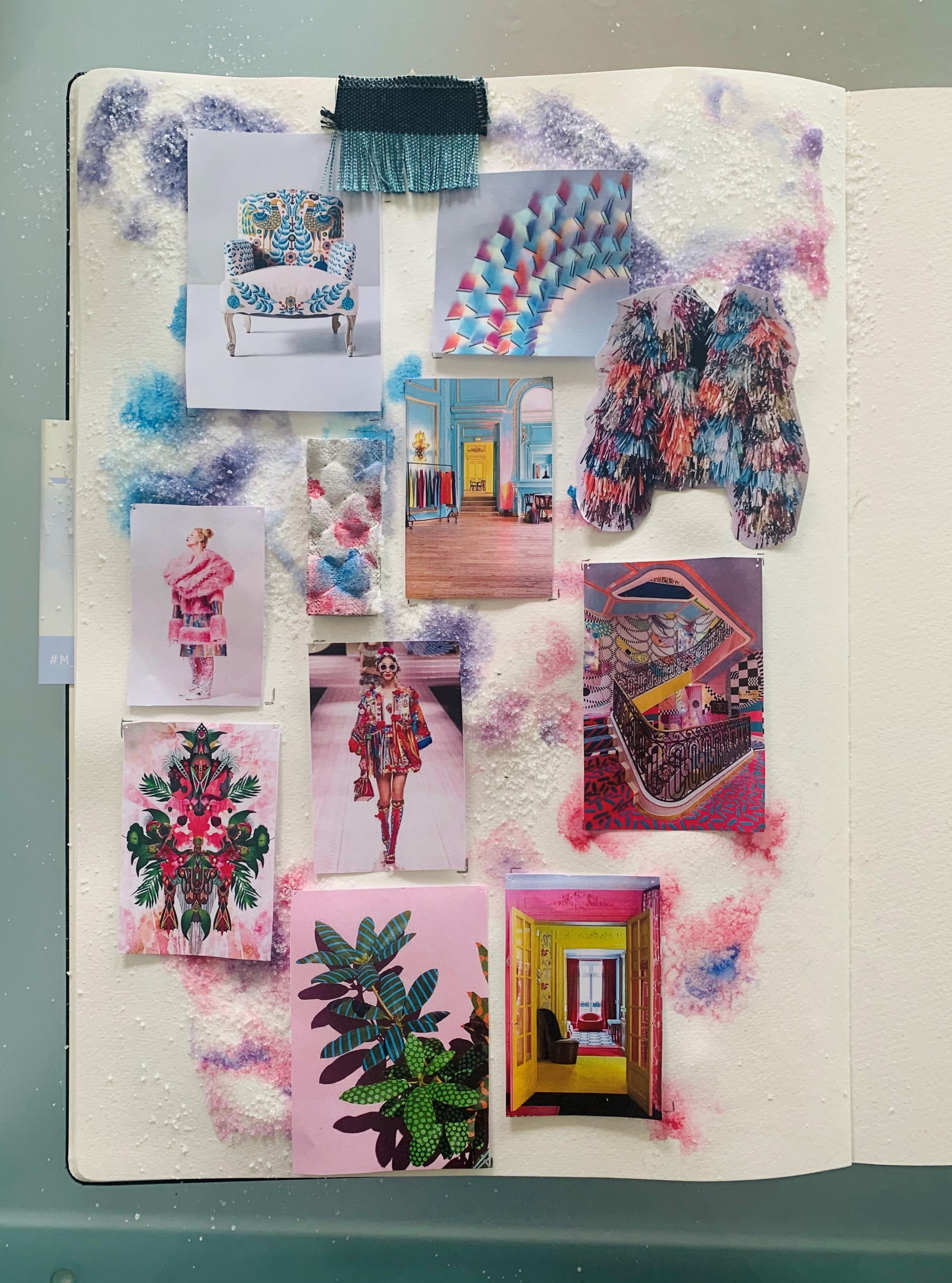A moodboard of different hues of pink and blue colours pinned to a white board